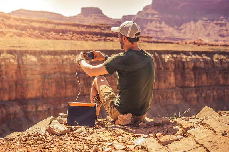 technology solar panel phone man nature beauty explore hike desert photo