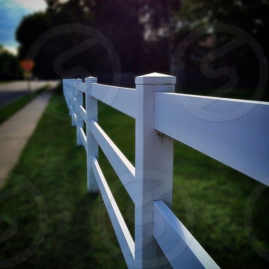 white wooden fence during daytime photo