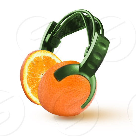 headphones in the form of an orange isolated on white photo