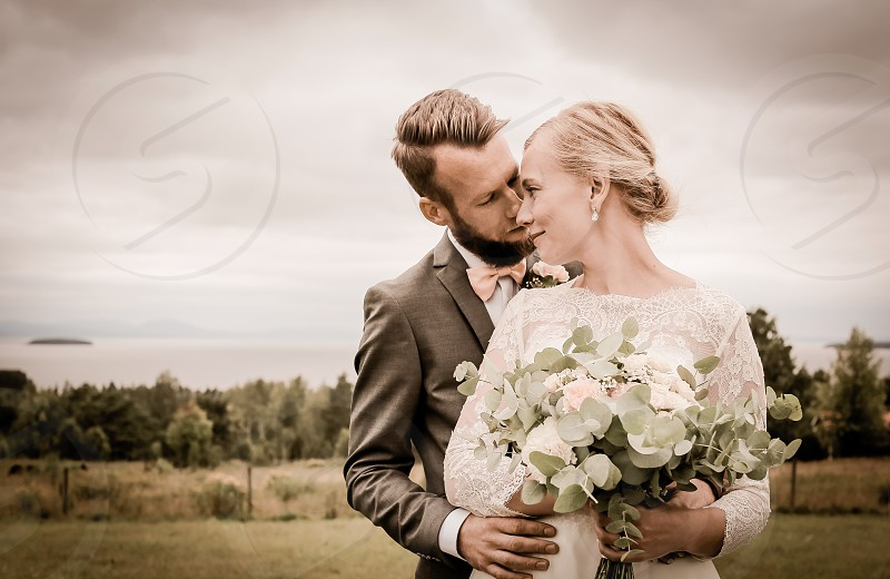 To have and to hold marriage  couple in love outdoors wedding wedding dress nature flower bouquet  photo