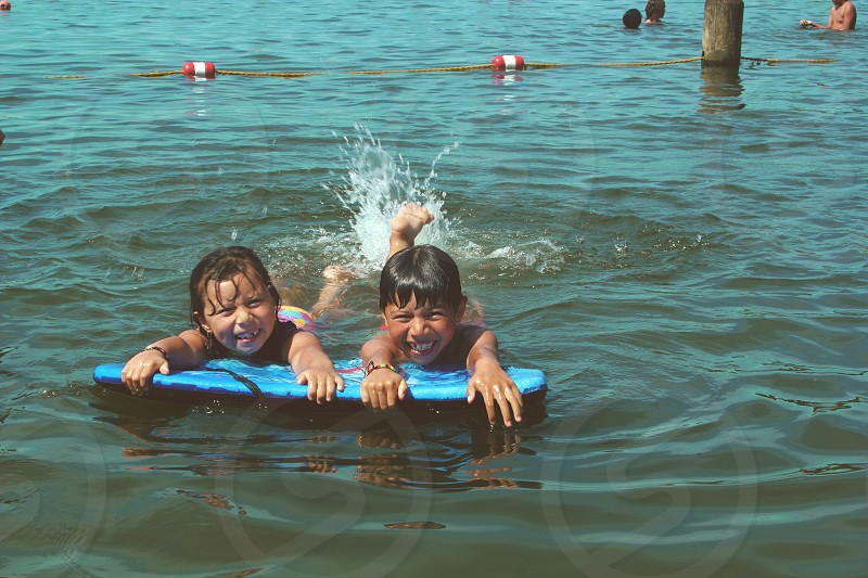 2 child swimming photo