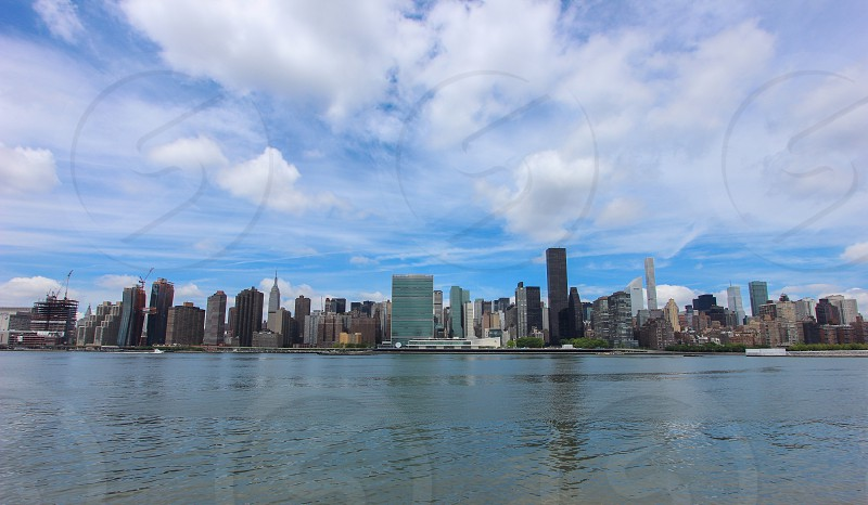 high rise buildings in front body of water photo
