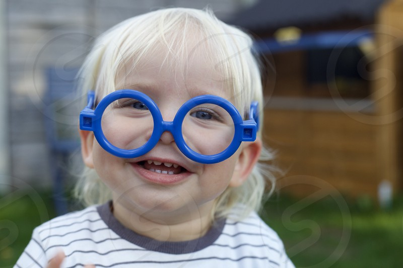 Toddler in toy glasses photo