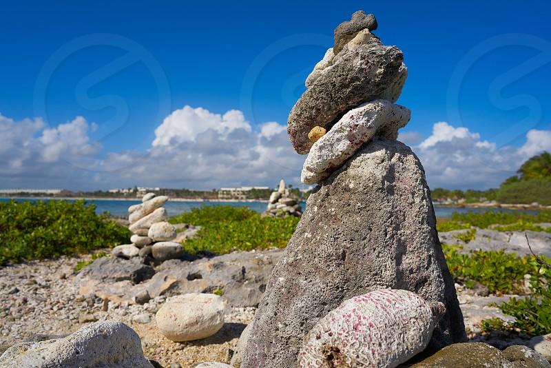 Akumal bay Cairn stone stacked in Riviera Maya of Mayan Mexico photo