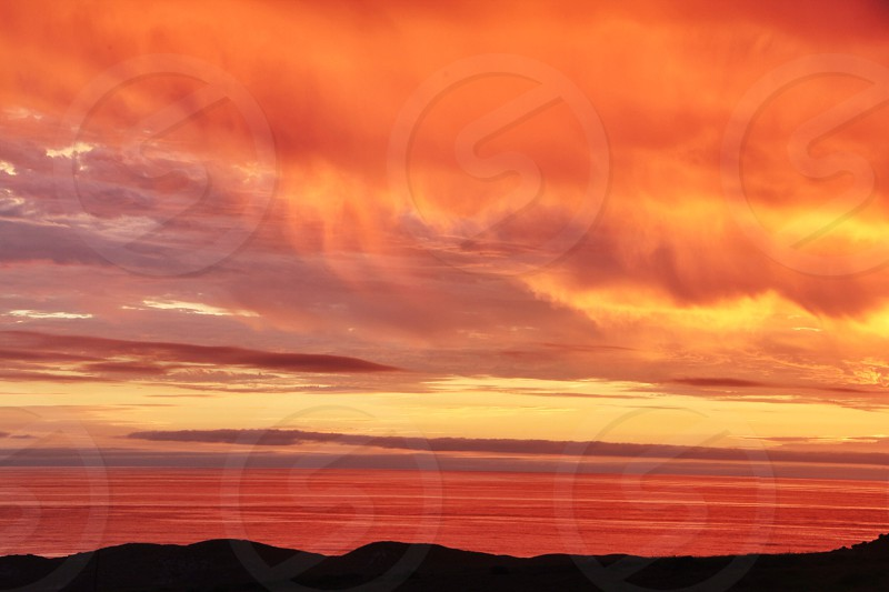 sunset colored reflection clouds photography by peter carey photo stock snapwire snapwire