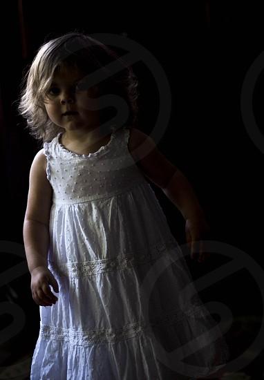 girl wearing white round neck sleeveless dress photo