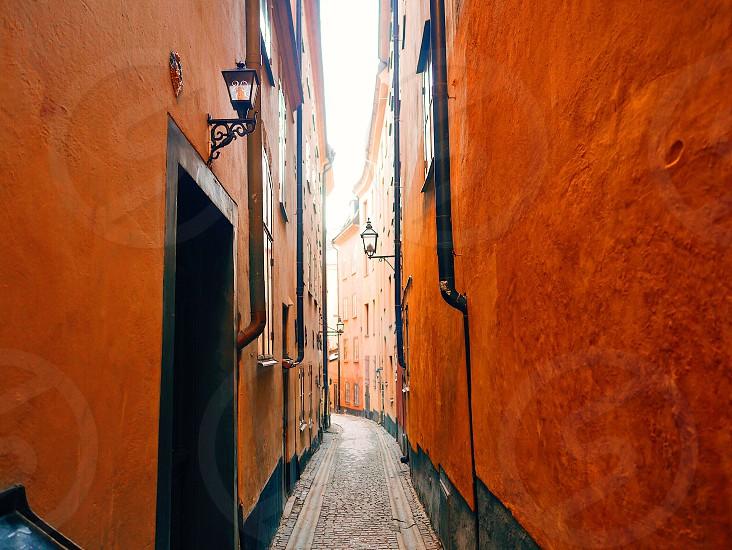 Architecture  architexture narrow street deep color orange colored  street Stockholm  Sweden  photo