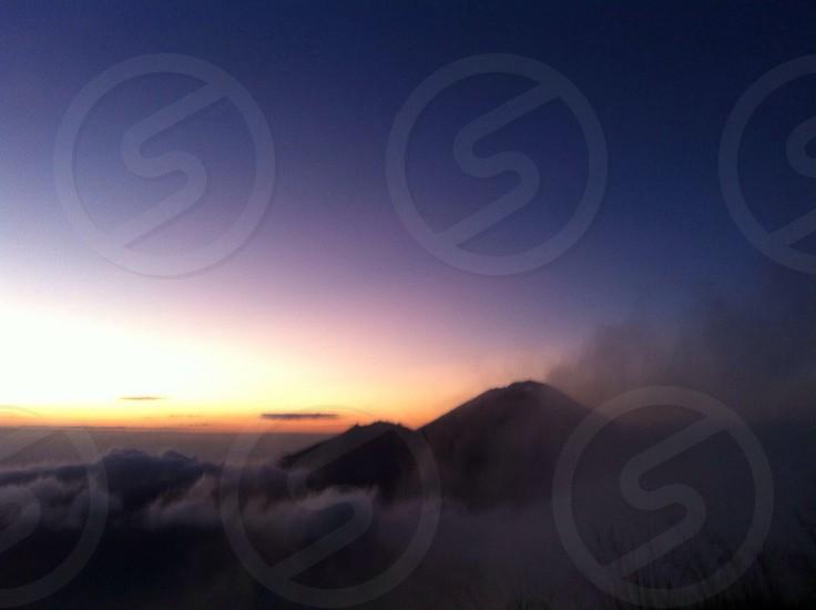 Sunrise at the peak of the volcano Mt. Batur photo