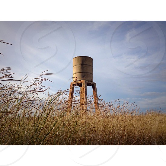 water tank in the middle of field photo