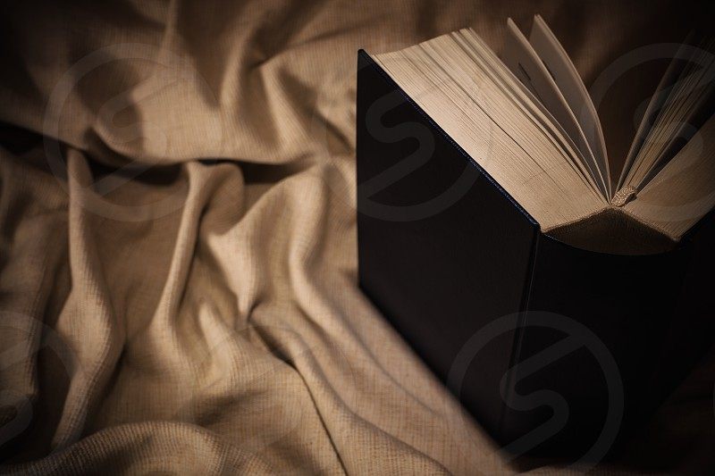 Closeup view of one big book on textile.  photo