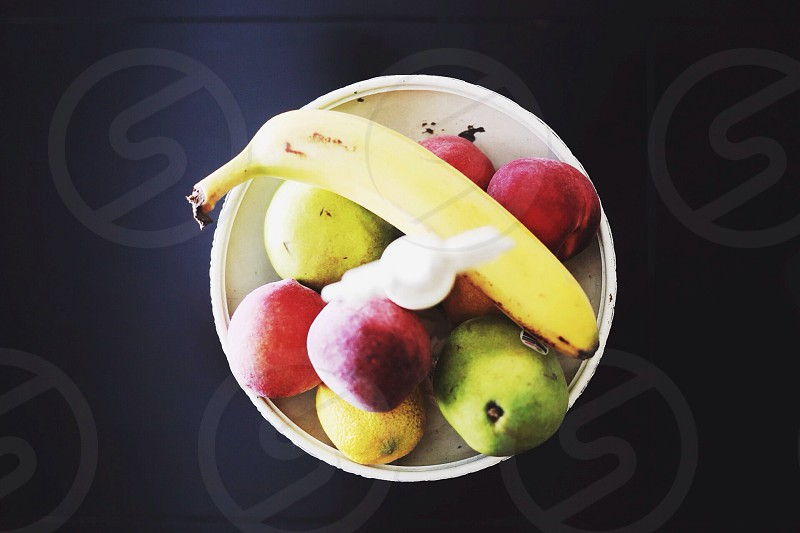view of fruits in white bowl photo