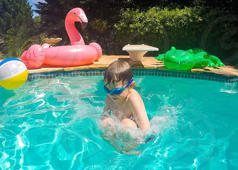 Cannon ball diving swimming boy photo