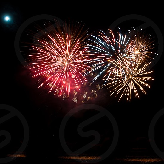 red and blue fireworks display photo