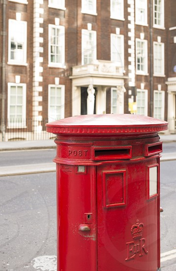 English style red mailboxe and vintage buildings photo