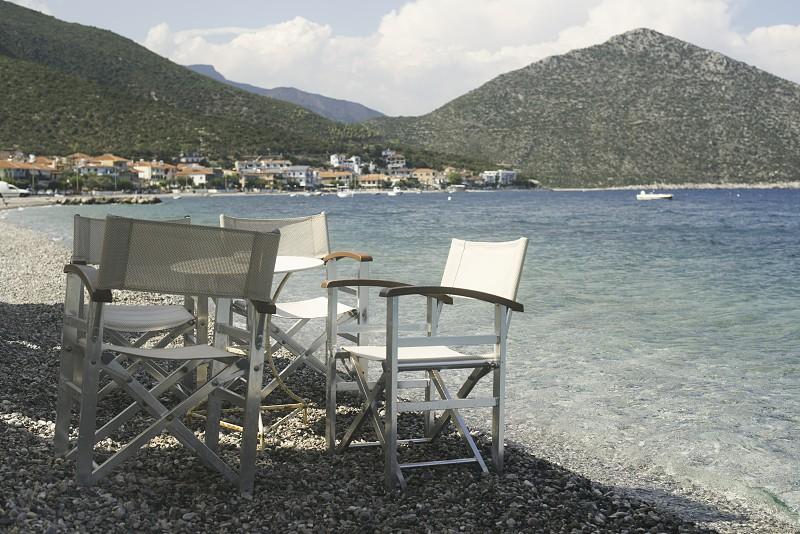 Chair in greek taverna on the beach photo