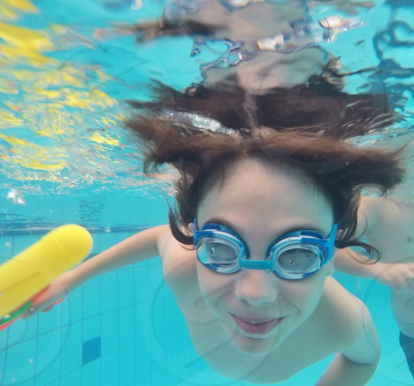 girl swimming on pool photo