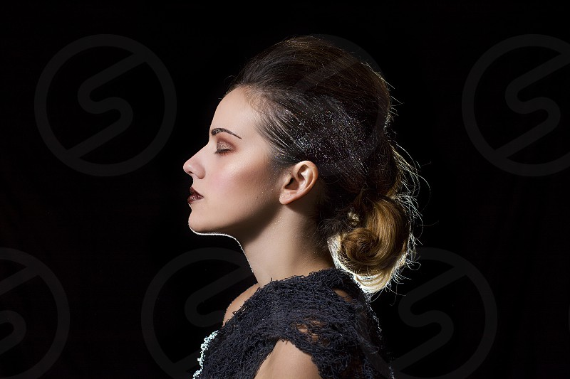 profile of woman with pony tail photo