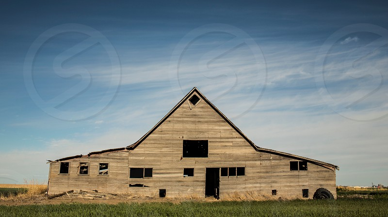 brown painted house near green grassy field photo