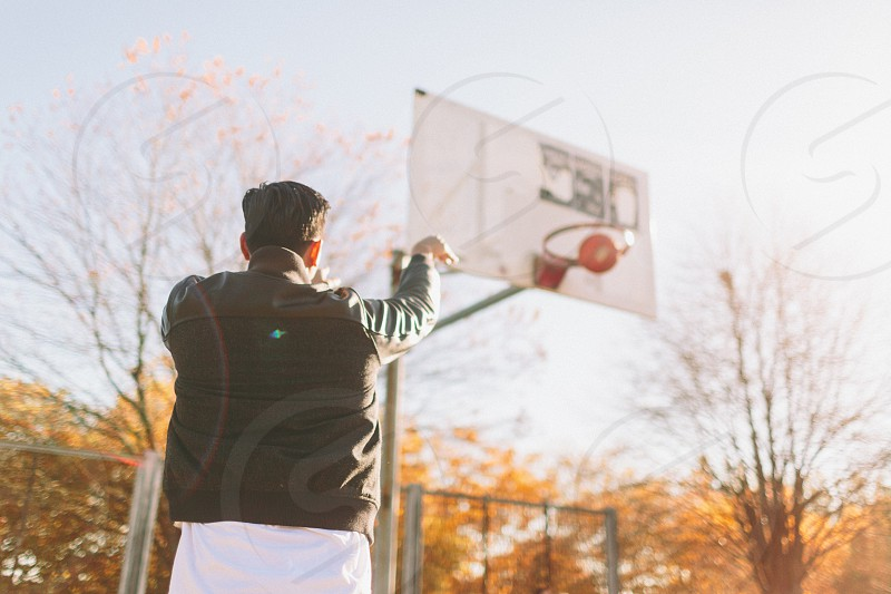 A young man playing basketball photo