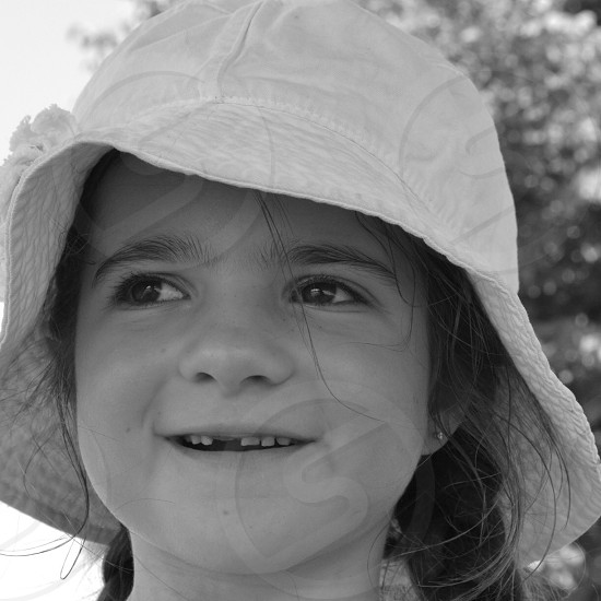 girl in white hat photo