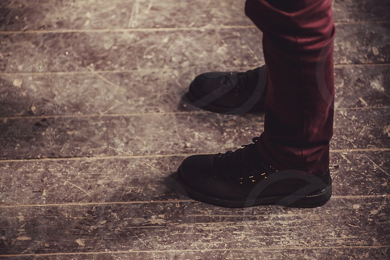 Abstract composition man is standing on old wooden floor.  photo
