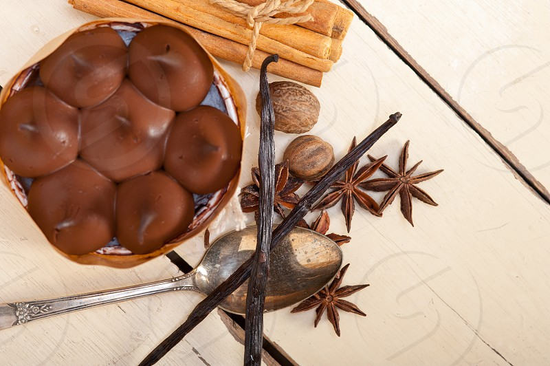 fresh baked chocolate vanilla and spices cream cake dessert over rustic wood table photo