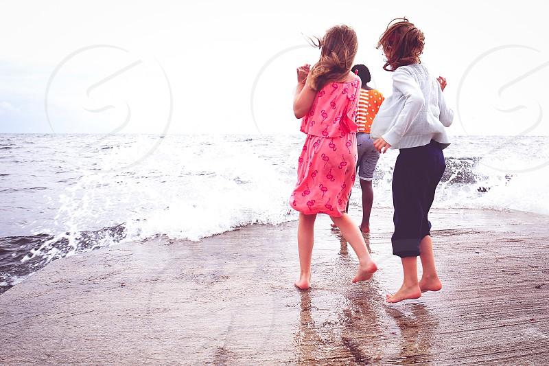 Friendship  sea water fun playing kids children  summer photo