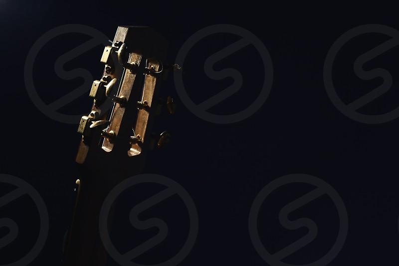 Gypsy acoustic guitar neck on dark background. photo