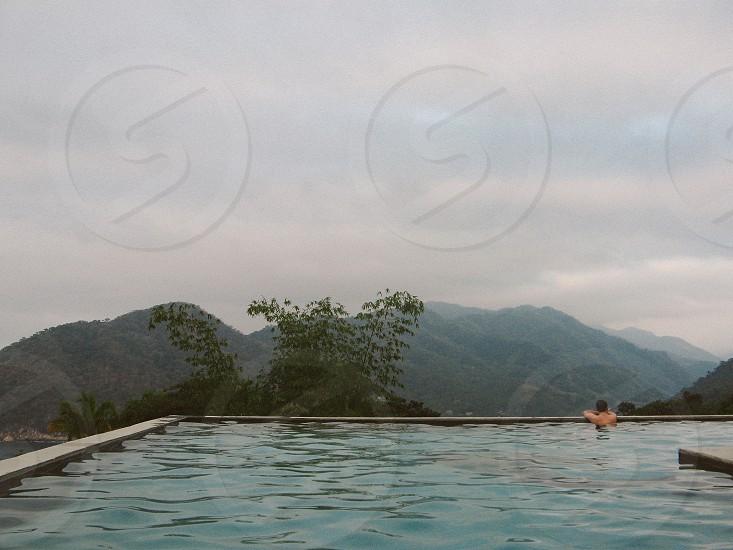explore // travel // pool // mountains photo