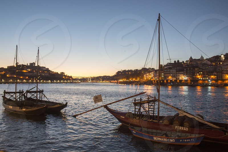the port wine Boats at the waterfront with the old town on the Douro River in Ribeira in the city centre of Porto in Porugal in Europe. photo