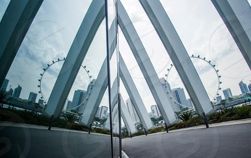 photography of gray concrete bridge near Ferris wheel collage photo