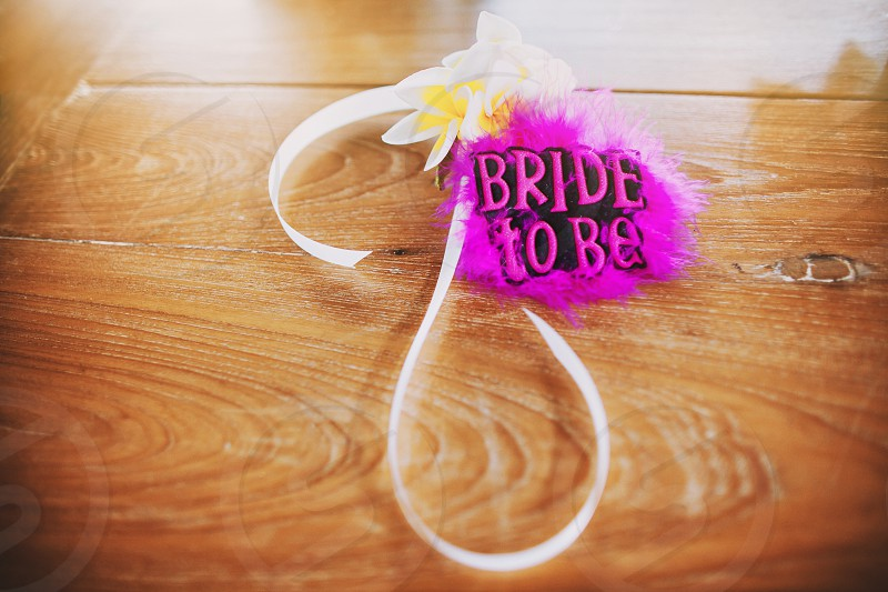 """Embellishment for wrist with white ribbon and flower decoration pink puffy hairy with text """"Bride to be"""" on it photo"""