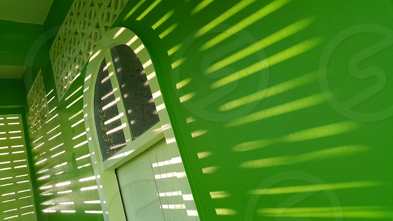 Construction the mosque the light from the sun green beautiful impressive. photo
