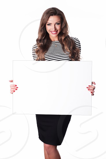 Beauty woman holding a white banner. photo