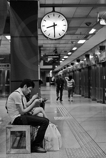 Time Train Waiting mobile phone. photo