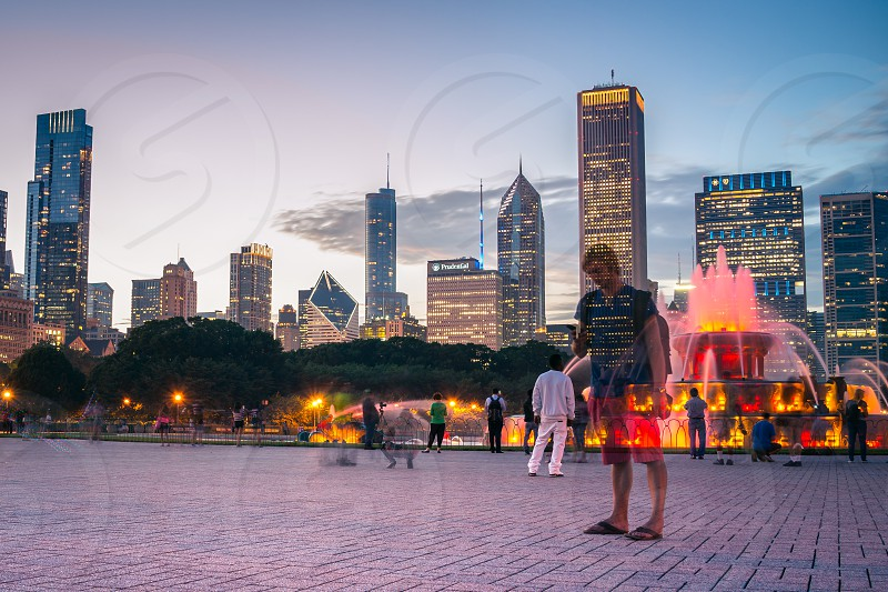 Chicago IL Chicago Chitown Downtown Square People Fountain Travel City Building Rental Rent Light Dark Bright Night Beautiful Citizens Walk Travelers Cityscape photo