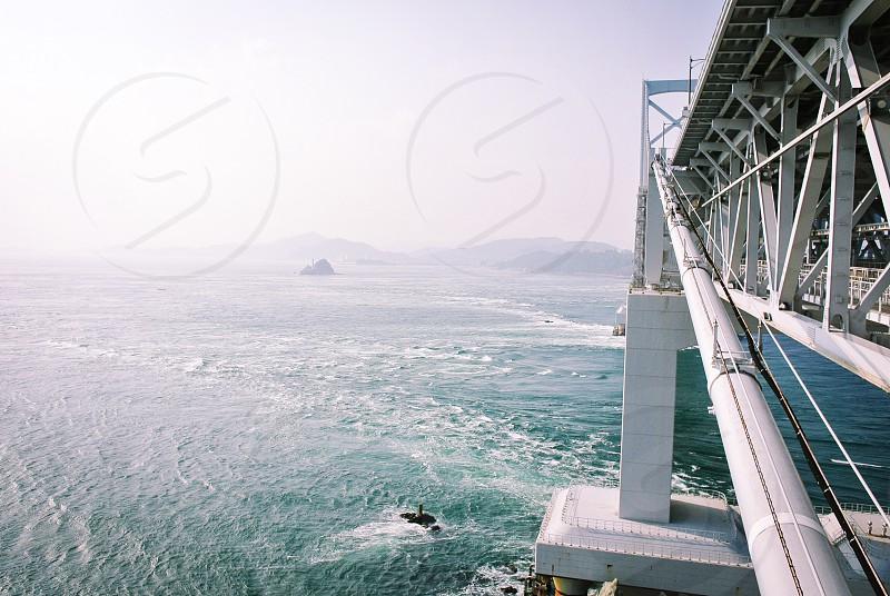 white steel bridge on water photo