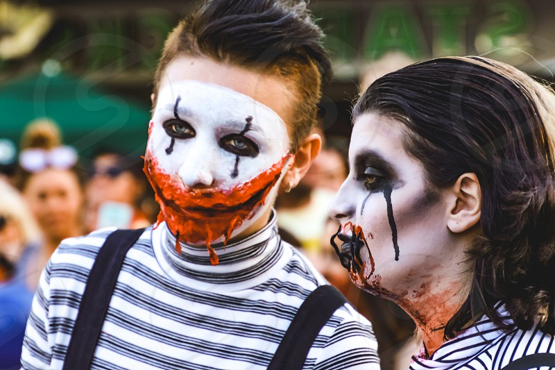 young couple in costume at a street parade face paint Halloween fun scary monster walking dead photo