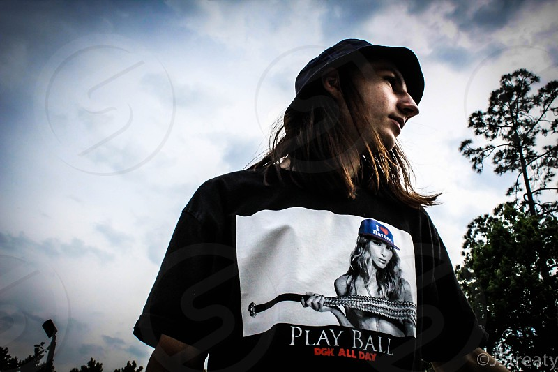 man in black and white play ball crew neck t shirt photo