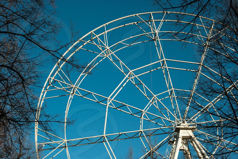 above photography of white ferries wheel under blue sky during day time photo