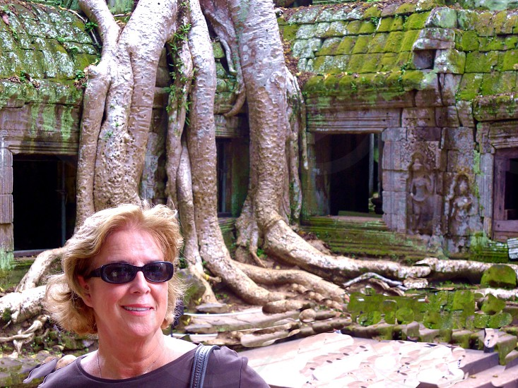 woman tree roots photo