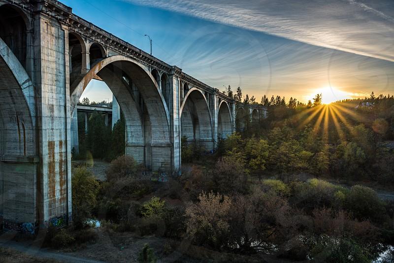 white bridge during sunset photo