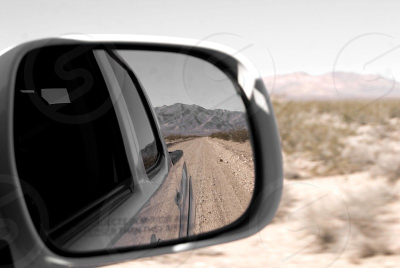 Reflection in the side view mirror photo