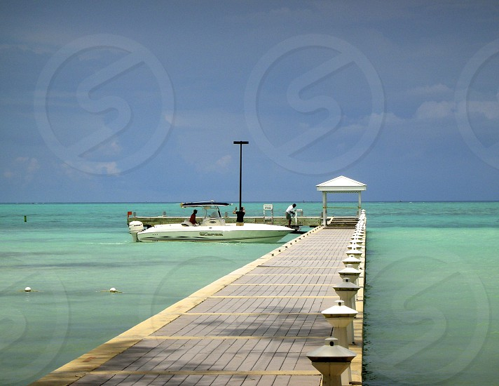 white speedboat on dock photo