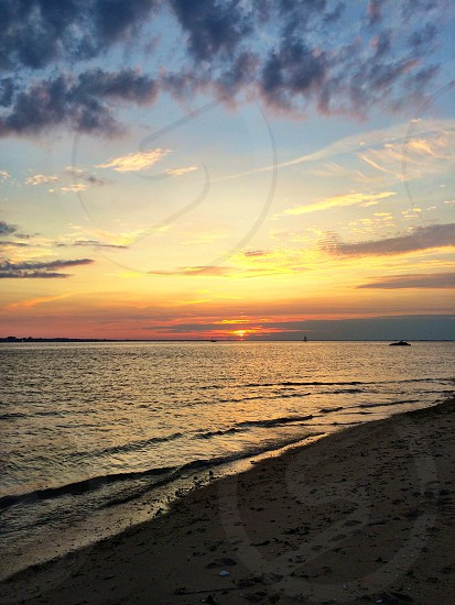 sea shore with sunset at the blue sky photo