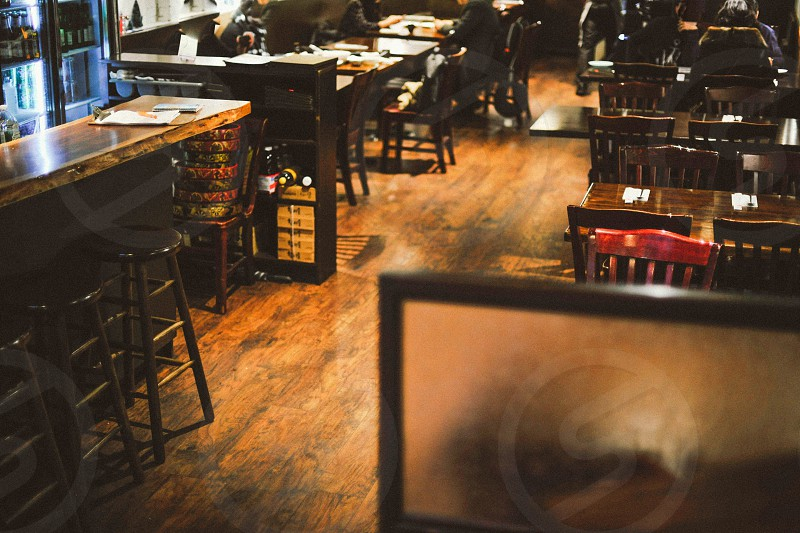 brown wooden tables with brown wooden bar stools photo