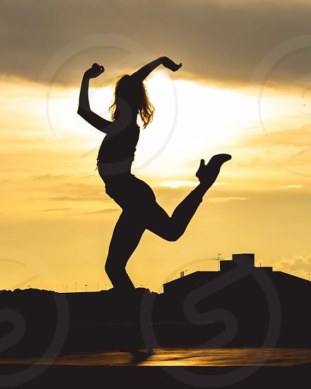 sihouette of girl dancing photo