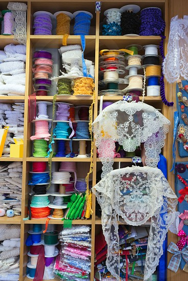 Valencia details of embroidery in old haberdashery in Plaza Redonda at Spain photo