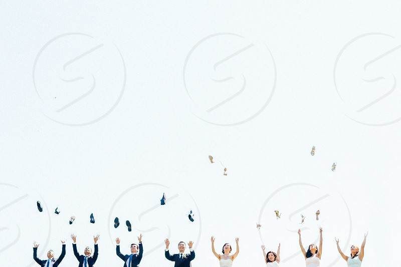 4 women and 4 men falling in line and throwing something photo