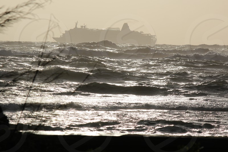 ship accompanied by waves photo